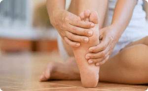 Woman massaging her plantar fasciitis pains
