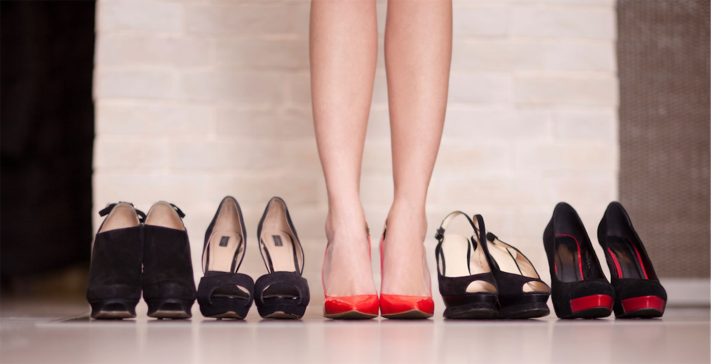 Woman trying out different shoes and high heels